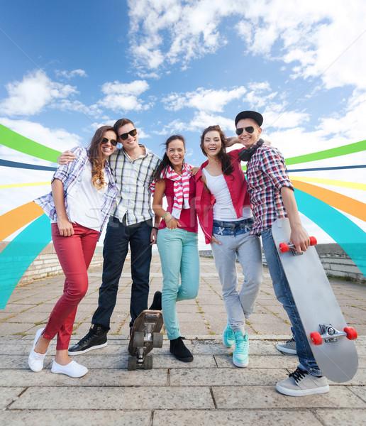 teenagers with skates outside Stock photo © dolgachov