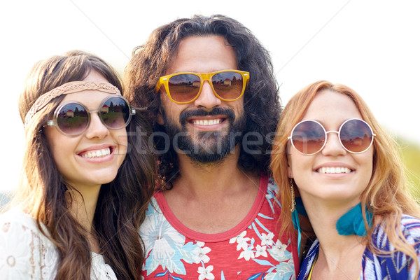 smiling young hippie friends outdoors Stock photo © dolgachov