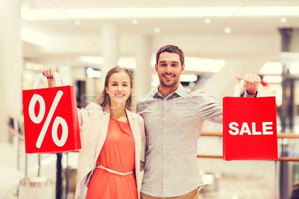 Stock fotó: Boldog · fiatal · pér · piros · bevásárlótáskák · bevásárlóközpont · vásár
