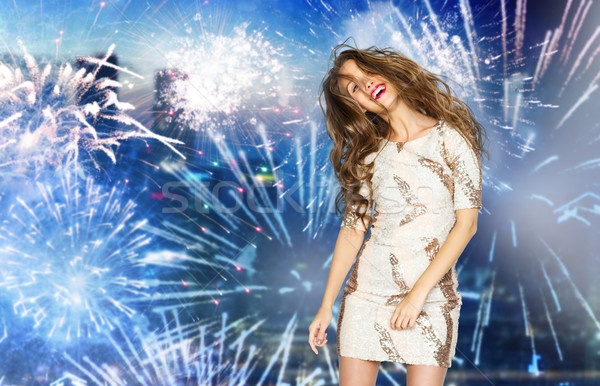 happy young woman dancing over firework at city Stock photo © dolgachov