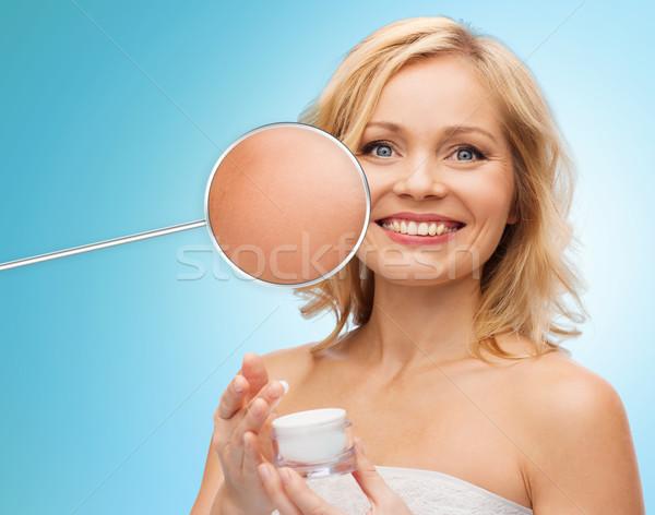 happy woman with cream jar Stock photo © dolgachov