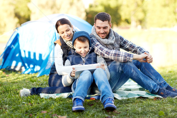 happy family with tablet pc and tent at camp site Stock photo © dolgachov