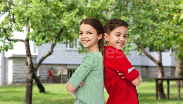 Stock photo: happy boy and girl standing together over backyard