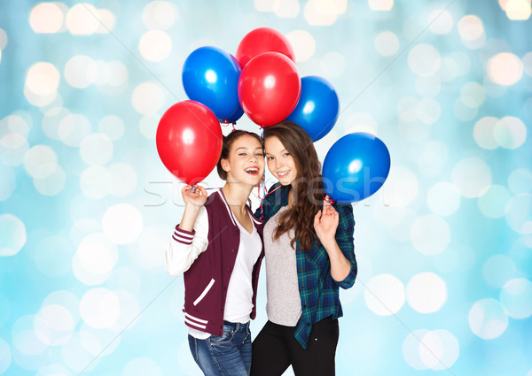 happy teenage girls with helium balloons Stock photo © dolgachov