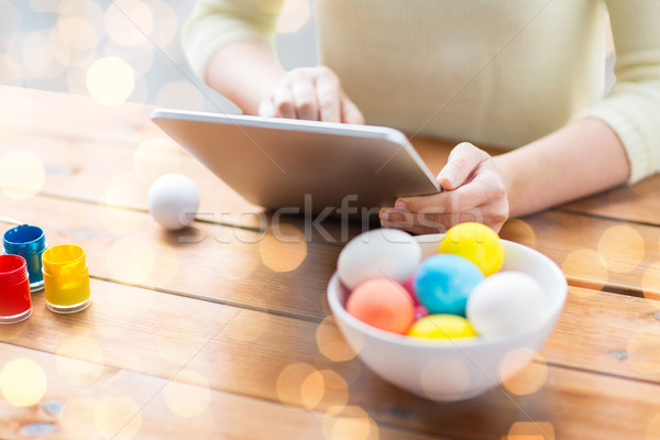 close up of woman with tablet pc and easter eggs Stock photo © dolgachov