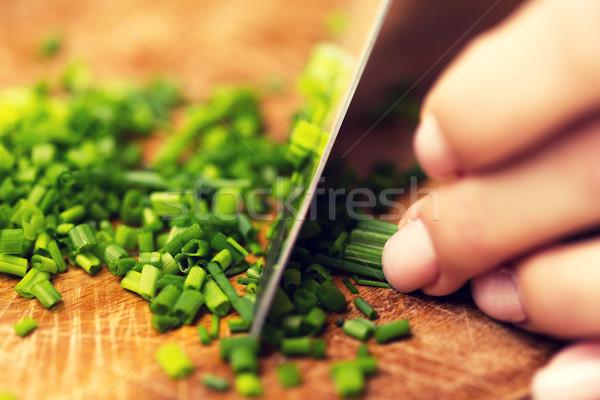 женщину зеленый лук ножом Сток-фото © dolgachov