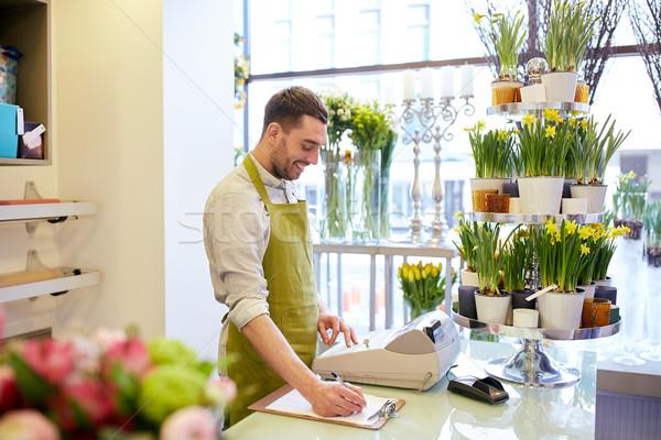 Florista hombre portapapeles contra personas Foto stock © dolgachov