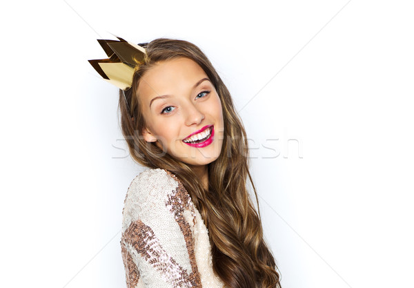 Stock photo: happy young woman or girl in party dress and crown