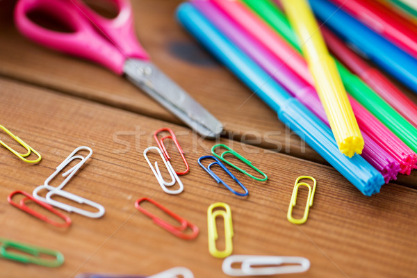close up of felt pens, clips and scissors Stock photo © dolgachov