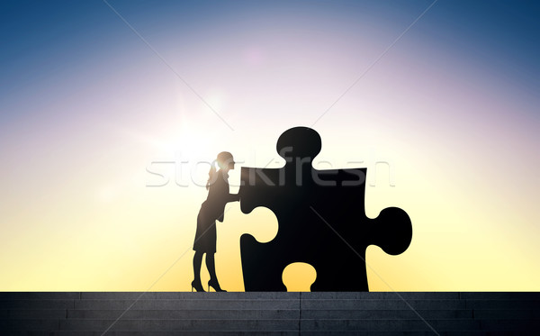silhouette of woman moving puzzle over sun light Stock photo © dolgachov