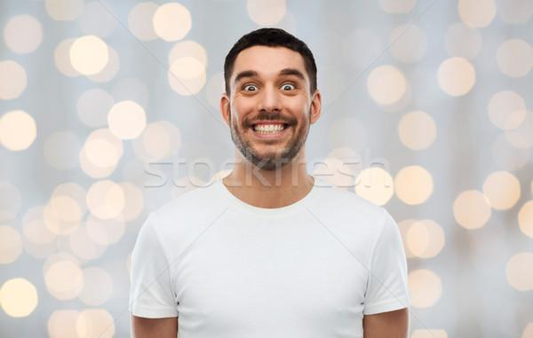 Człowiek funny twarzy światła emocje ludzi wakacje Zdjęcia stock © dolgachov