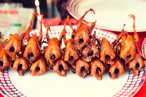 grilled or fried quail on plate at street market Stock photo © dolgachov