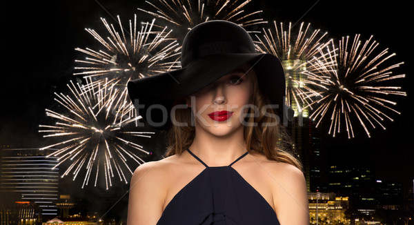 beautiful woman in black hat over night firework Stock photo © dolgachov