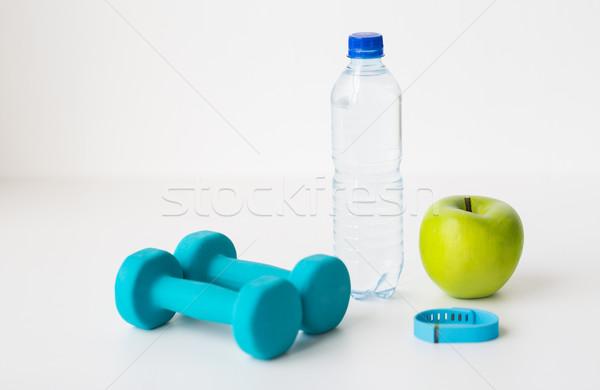 dumbbells, fitness tracker, apple and bottle Stock photo © dolgachov