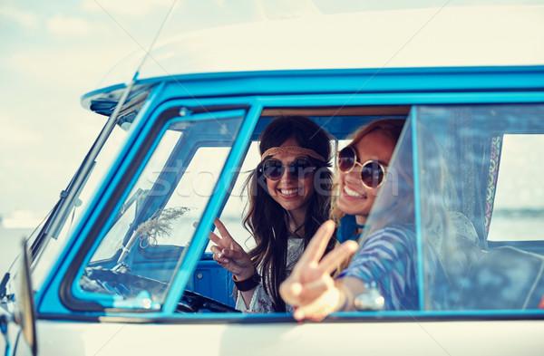 smiling young hippie women driving minivan car Stock photo © dolgachov