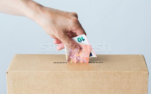 Adam euro para bağış kutu hayır Stok fotoğraf © dolgachov