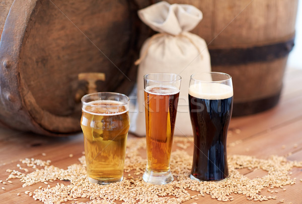 close up of beer barrel, glasses and bag with malt Stock photo © dolgachov