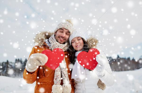 Feliz Pareja rojo corazones invierno paisaje Foto stock © dolgachov