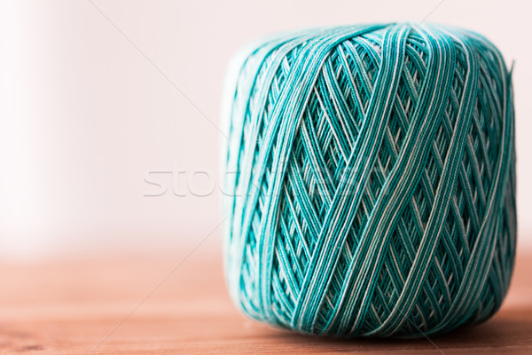 ball of turquoise cotton yarn on wood Stock photo © dolgachov