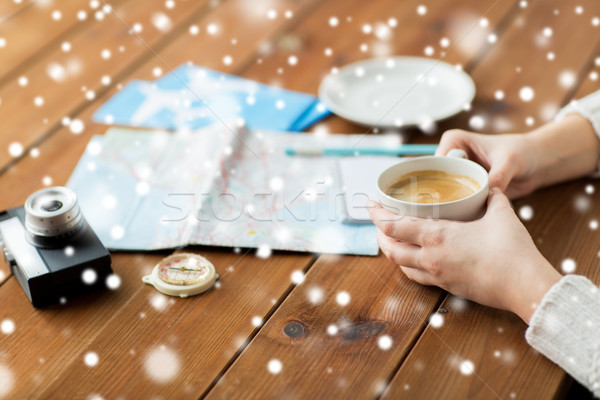 hands with coffee cup and travel stuff Stock photo © dolgachov