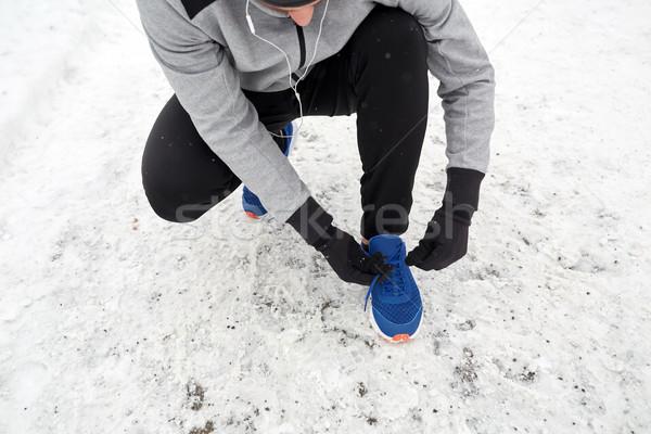 ストックフォト: 男 · イヤホン · スポーツ · 靴 · 冬 · フィットネス
