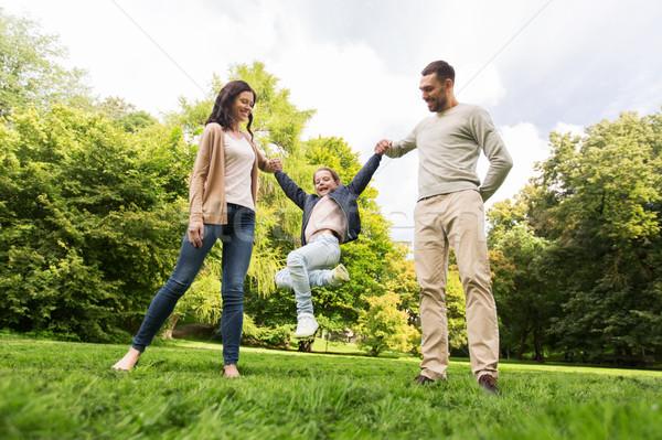 Boldog család sétál nyár park szórakozás család Stock fotó © dolgachov
