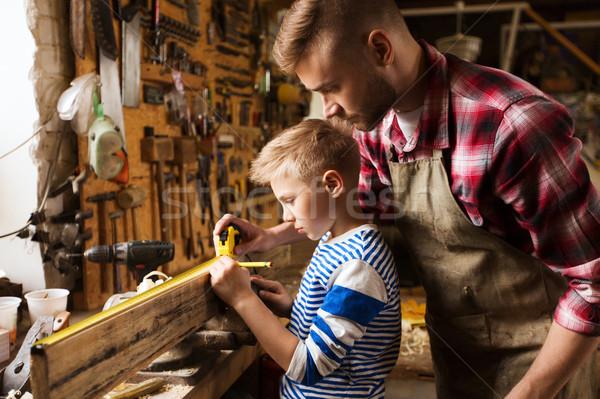 Apa fia vonalzó méret fa műhely család Stock fotó © dolgachov