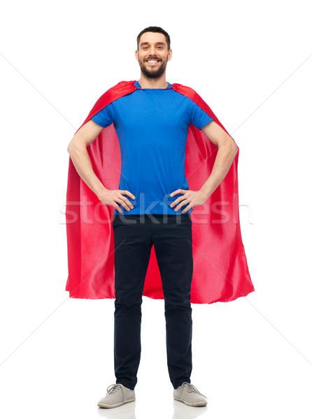 happy man in red superhero cape Stock photo © dolgachov