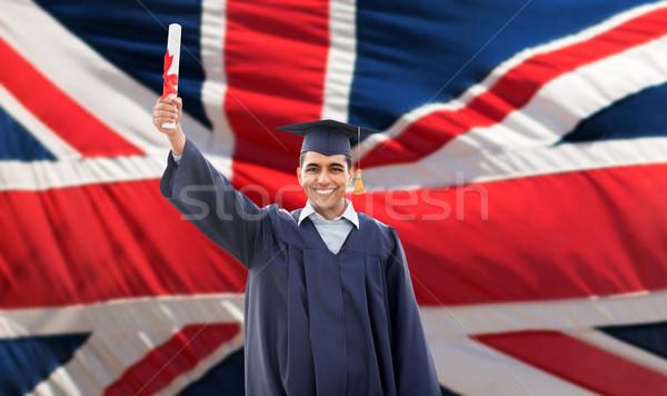 Boldog férfi diák diploma brit zászló oktatás Stock fotó © dolgachov
