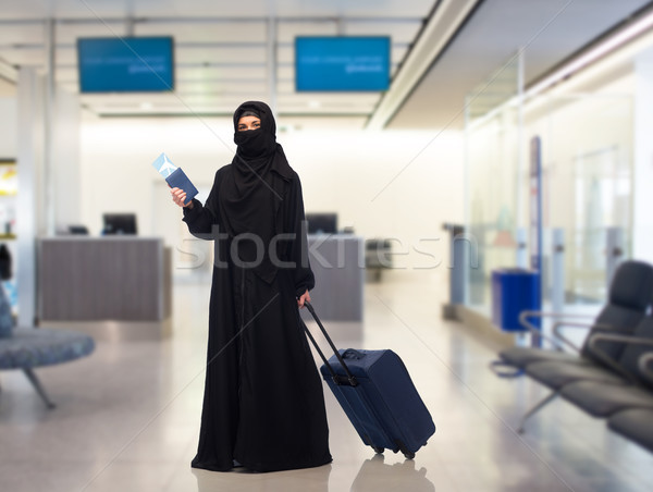 muslim woman with ticket, passport and travel bag Stock photo © dolgachov