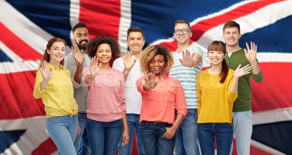 Nemzetközi csoport boldog emberek integet kéz diverzitás Stock fotó © dolgachov