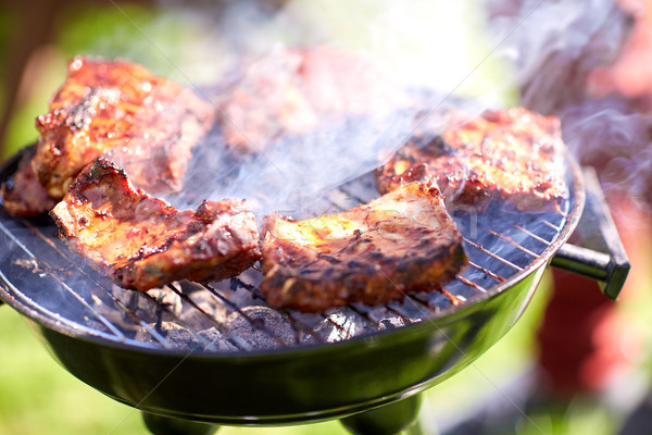 Stock photo: meat cooking on barbecue grill at summer party
