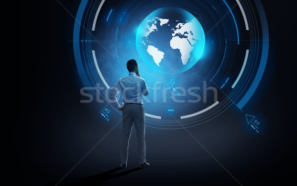 businessman looking at virtual earth projection Stock photo © dolgachov