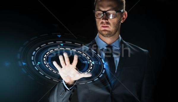 Işadamı dokunmak sanal ekran projeksiyon iş adamları Stok fotoğraf © dolgachov