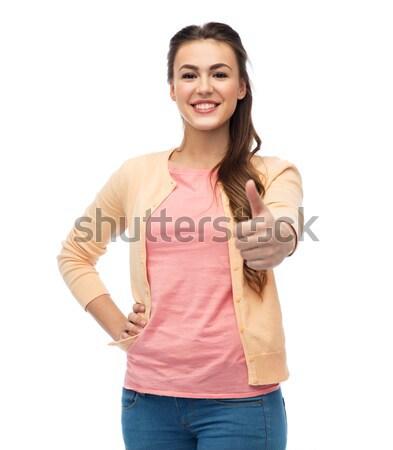 Feliz sorridente mulher jovem gesto Foto stock © dolgachov