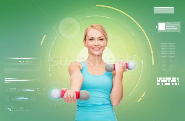happy sporty woman with dumbbells flexing biceps Stock photo © dolgachov