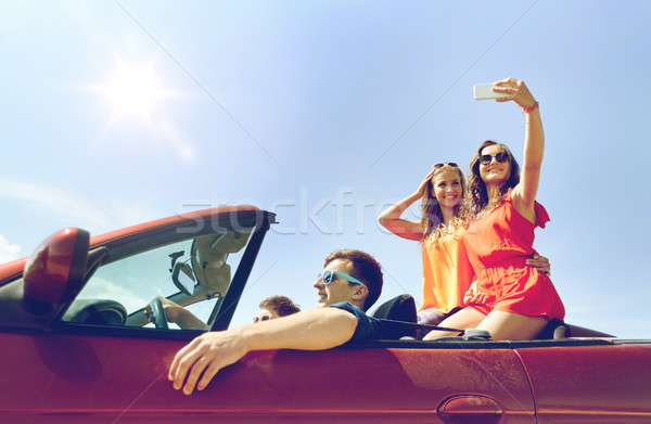 Amigos condução cabriolé carro lazer Foto stock © dolgachov