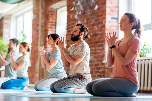 group of people meditating at yoga studio Stock photo © dolgachov