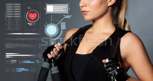 close up of sporty woman with jumping rope Stock photo © dolgachov
