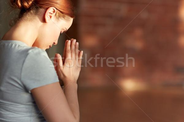 close up of woman meditating at yoga studio Stock photo © dolgachov