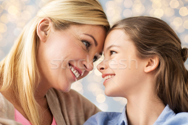 happy family of girl and mother Stock photo © dolgachov