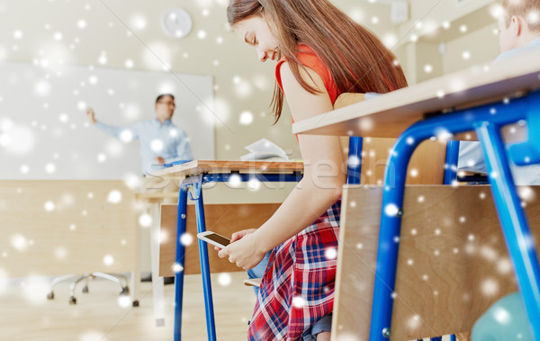 Diák lány okostelefon sms chat iskola oktatás Stock fotó © dolgachov