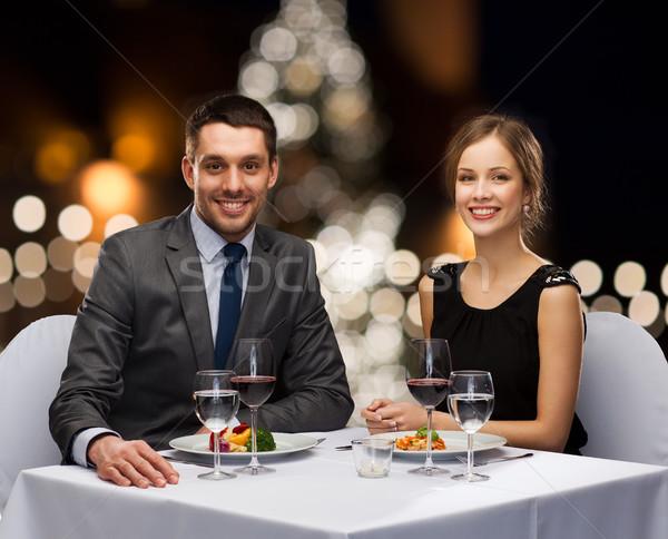 Pár felszolgált étterem asztal karácsony emberek Stock fotó © dolgachov