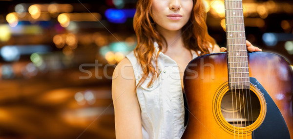 close up of female musician with guitar Stock photo © dolgachov