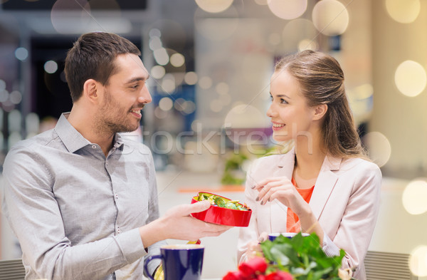 happy couple with present and flowers in mall Stock photo © dolgachov