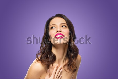 beautiful woman with lipstick over ultra violet Stock photo © dolgachov