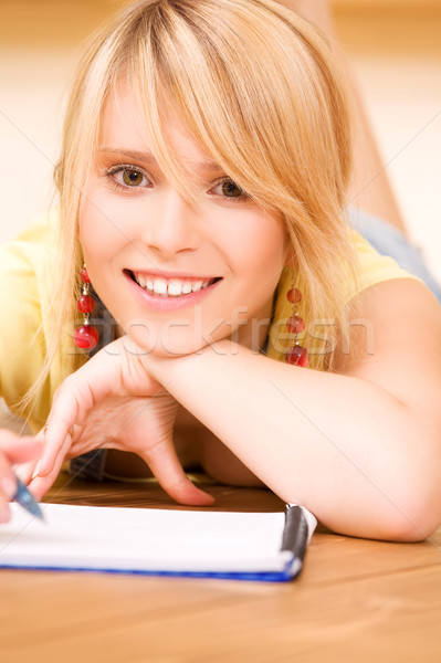 teenage girl with notebook and pen Stock photo © dolgachov