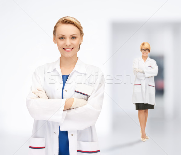 two attractive female doctors Stock photo © dolgachov