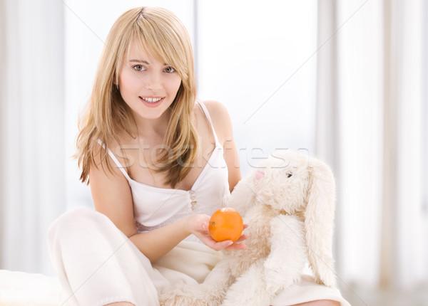 Narancs fényes kép szőke nő nő étel Stock fotó © dolgachov