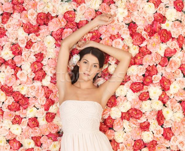 полный роз красивой женщину цветы Сток-фото © dolgachov